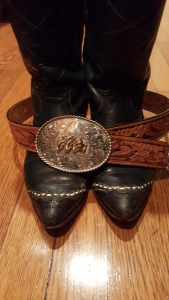 Cowboy boots and a belt buckle.