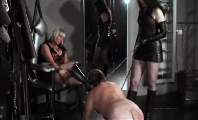 Mistress Shane & Vinyl Queen torment a slave.